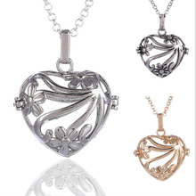 HX048 Yiwu Huilin Jewelry Flower vine pattern essential oil diffuser heart charm necklace