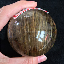 Wholesale natural rock rutilated quartz crystal ball / sphere
