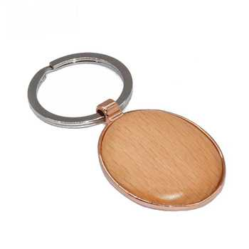 Cheap bulk made in china custom logo design wooden keychain round wood keyring