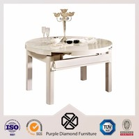 White extendable round glass dining table