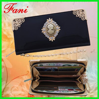 Latest design fashion PU leather ladies purse with elegant metal flower frame