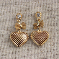 Hot sell simple hollow bowknot earrings with heart