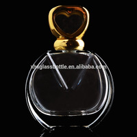 fancy beautiful 100ml woman perfume glass bottle with shiny gold heart shaped perfume cap wholesale