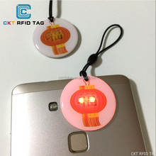 Promotional LED NFC key tags with Ultralight EV1 for NFC loyalty programs
