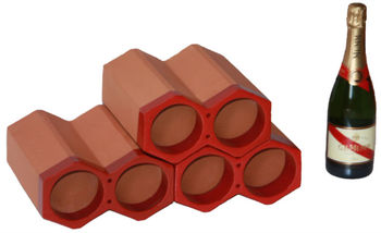 Spanish, terracotta, stackable single glazed ceramic brown wine holders and bottle racks, made of clay