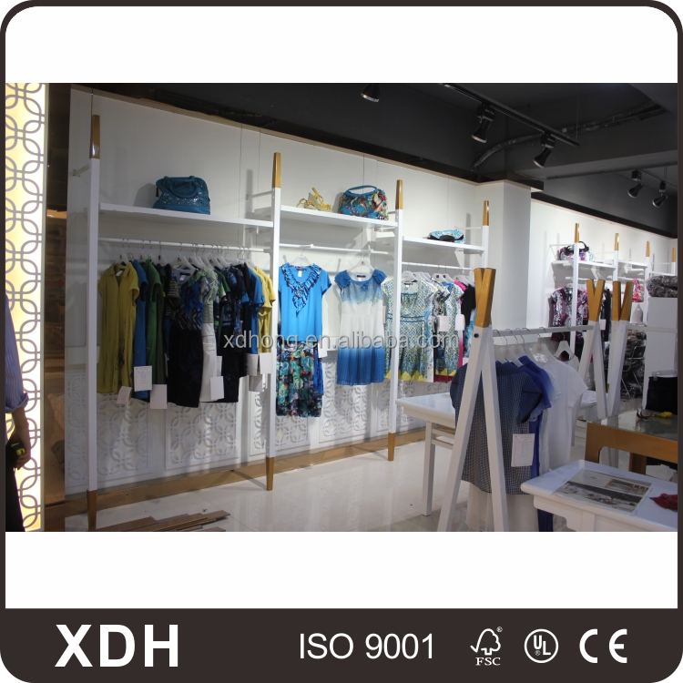 Modern style retail clothing store display garment shop counter design