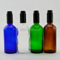 Round shaped 100ml glass perfume bottle in dubai wholesale pump airless glass dropper bottle