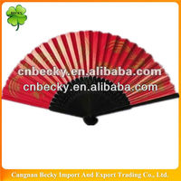Oriental hand fans with black bamboo ribs and red paper surface