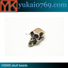 Metal skull beads with glow in the dark eyes