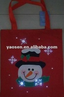 Red christmas felt gift bag with fiber optical light
