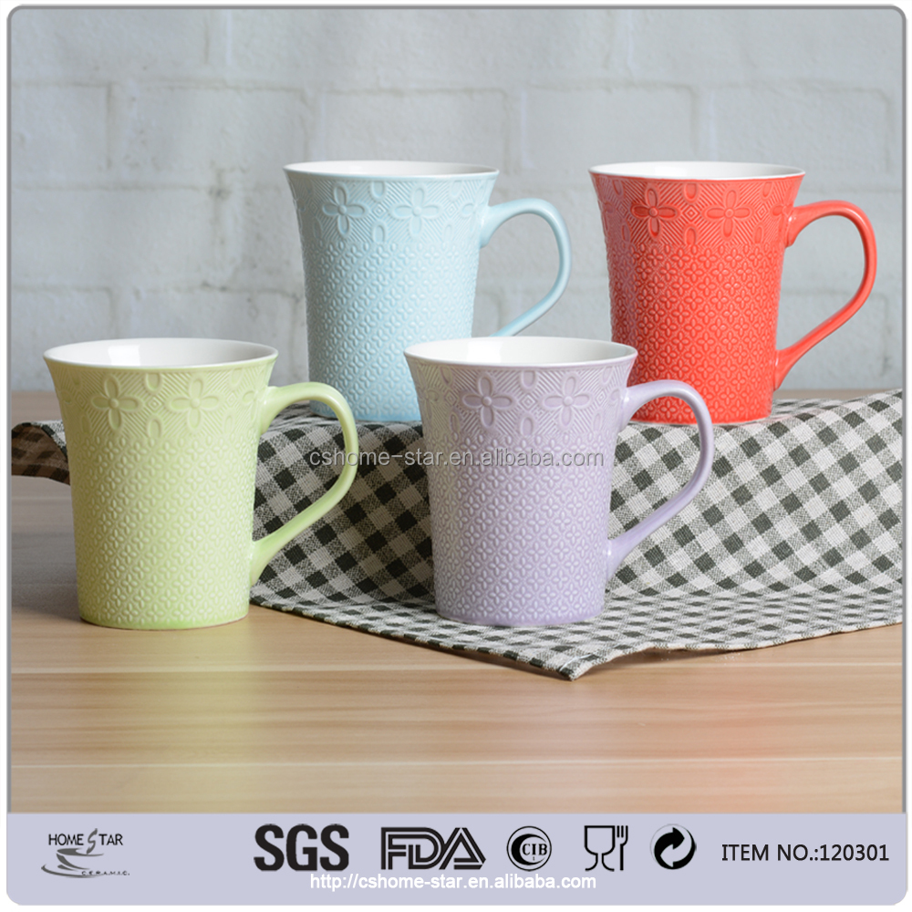 Best quality color glazed porcelain embossed pottery coffee mugs
