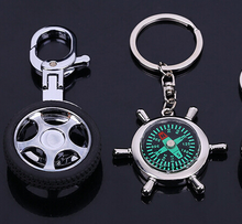 promotional gfts rudder keychain, wheel design custom keyring, football style key ring
