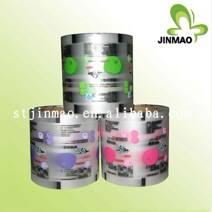 Multilayer plastic printing roll film for packaging bag