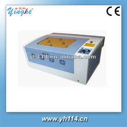 manufacture Guangzhou with CE approval co2 die board laser cutting machin