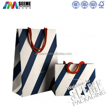 Wholesale manufacture printed black and white stripes paper gift bag