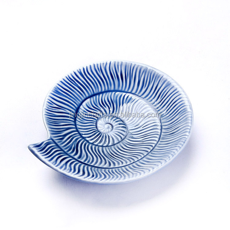 white and blue ocean series porcelain bowls and plates