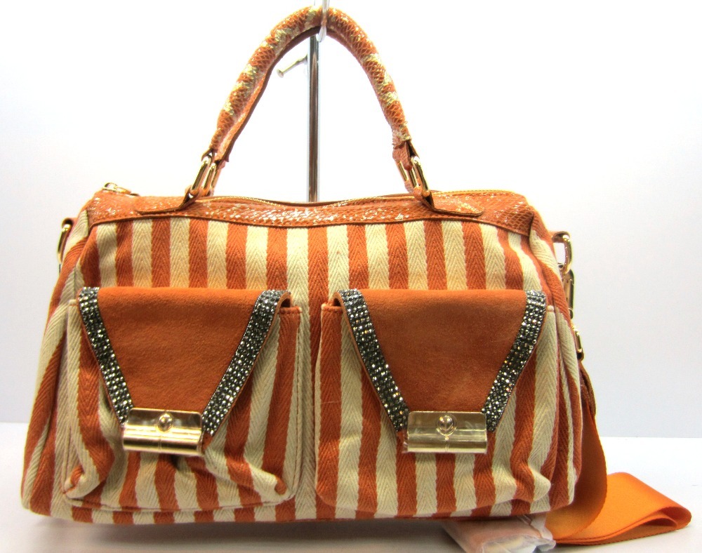 high range lady handbag with metal and two outside pockets