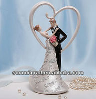 bride and groom embrace a romantic heart background decorate wedding cake table