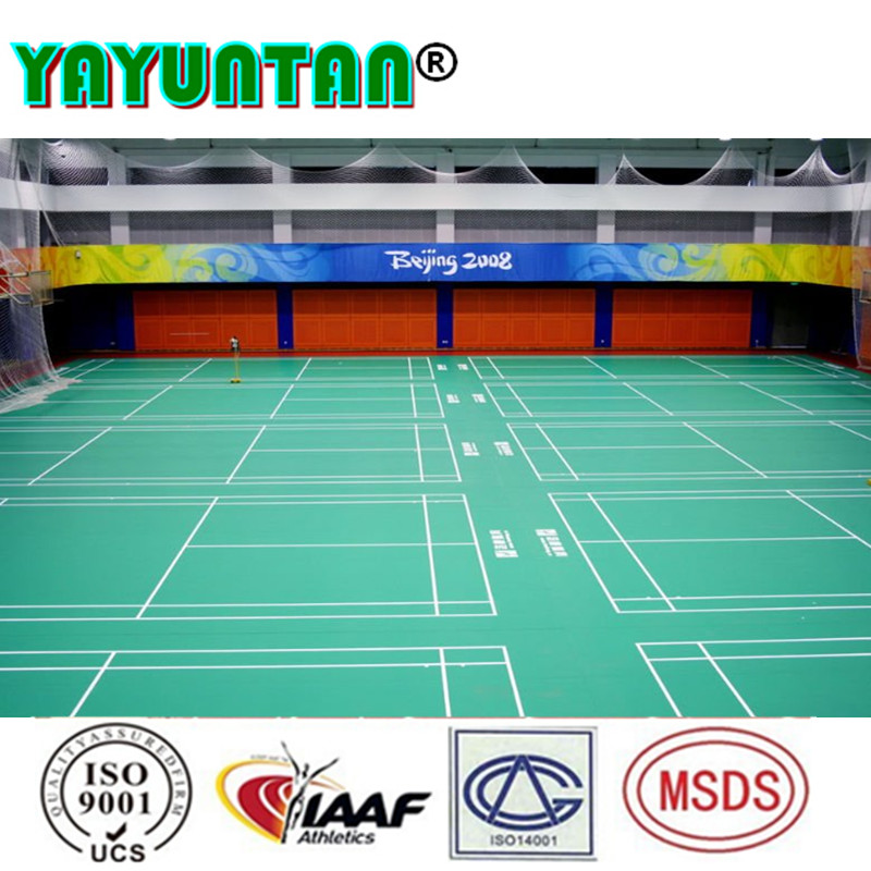 Synthetic badminton court surface for indoor sport