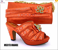 Crystal and rhinestone evening matching orange shoes and bags