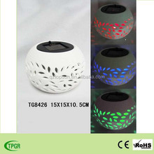 ceramic pot with color changing led solar light for home and garden decoration