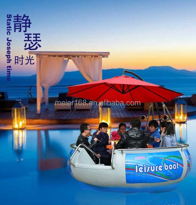 Round electric motor round boat with bbq grill