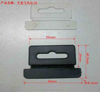 Injection molded euro hole hang tabs