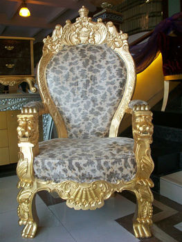 Royal wooden armchair with golden lion hand carving