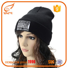 OEM knit beanies custom slouchy merino wool beanie with embroidery badge
