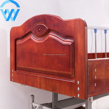 China Supplier Luxury Medical Adjustable Two Cranks Manual Nursing Bed Wooden Home Care Bed For The Elderly