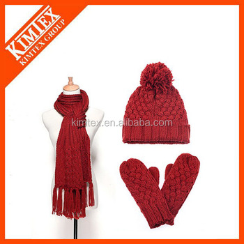 Knitted women winter hat and scarf set