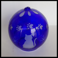 handmade blue colored glass wind chime with sandblasted cat