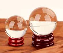 Top Selling High Quality Asian Quartz Pure Clear Magic Crystal Glass Healing Ball Sphere 60mm with wooden Base Home Decoration