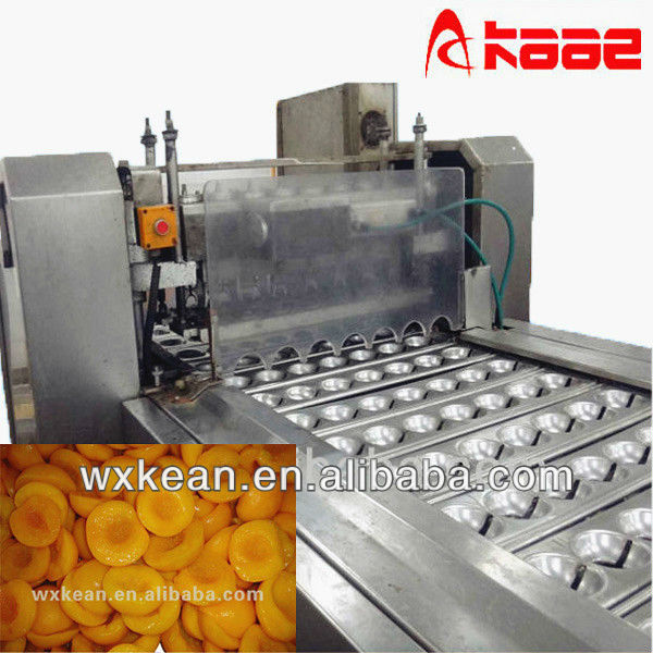 Automatic apricot and peach cutter and pitter