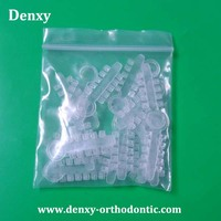 China Orthodontics Manufacturer Clear / Silver color Dental braces Dental rotation wedge