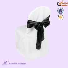 white chair cover with black sash for wedding