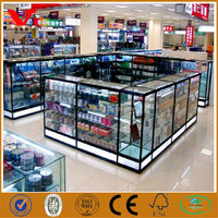 Combined glass display counter and cabinets for computer store used