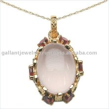 Passionately pick rose quartz oval gemstone surrounded by deep red garnets in gold plated sterling silver pendant!!