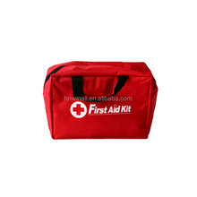 Red emergency first aid kit for travel