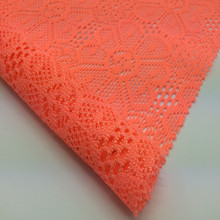 Hot sell 100%T orange knitted cord tulle lace fabric for dress