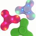 Promotion LED light release pressure hand toys spinner finger gyro with wireless speaker
