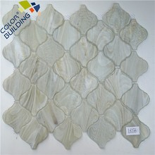 Cloudy arabesque mosaic tile coming on net glass lantern wall background