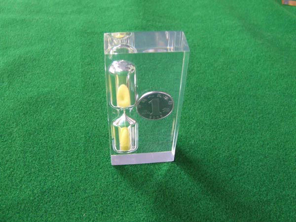 clear acrylic paperweight with coin inside