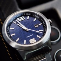 Racing inspired automatic watches featuring exotic dial materials including Blue Carbon,Carbon dial