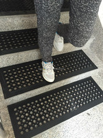 Anti-slip scraper and permeable porous rubber mat