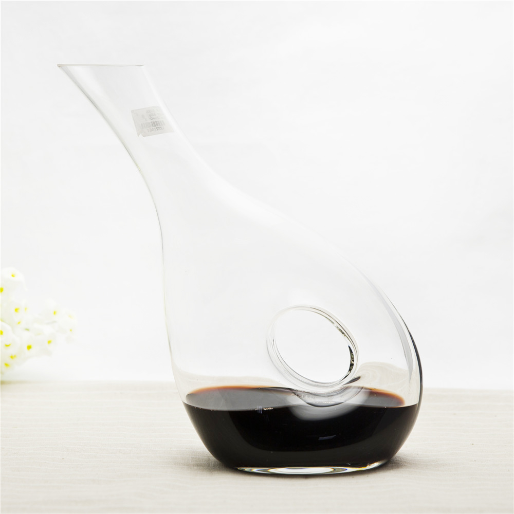 Art clear glass slant wine decanter with a hole in the middle esay hold