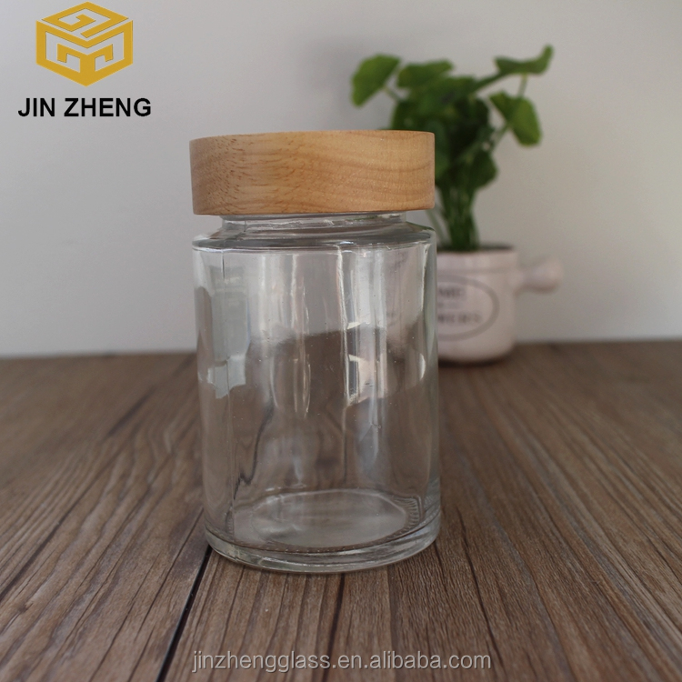2016 hot sale 150ml 300ml clear round honey glass jar with wooden lid