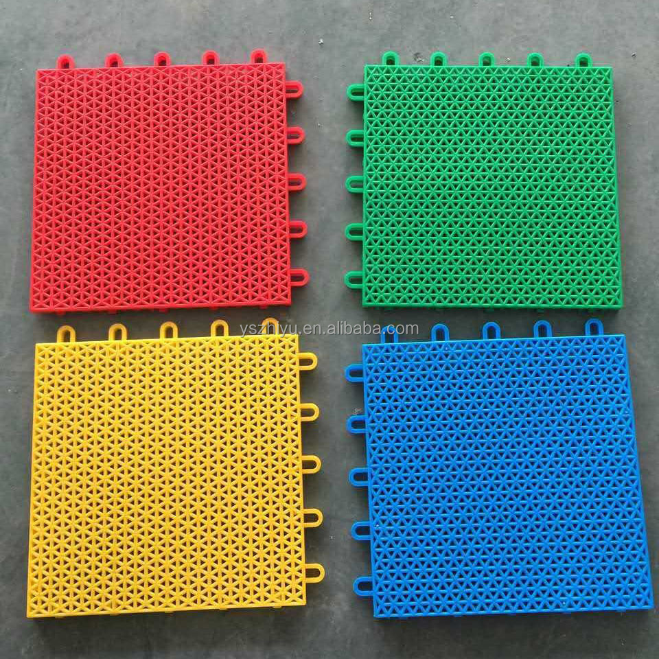 Plastic interlocking floor tiles