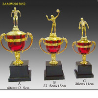 gold color metal sports trophy cup with figurines
