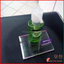clear acrylic Maybelline cosmetics bottle display holder stand with a hole for retail